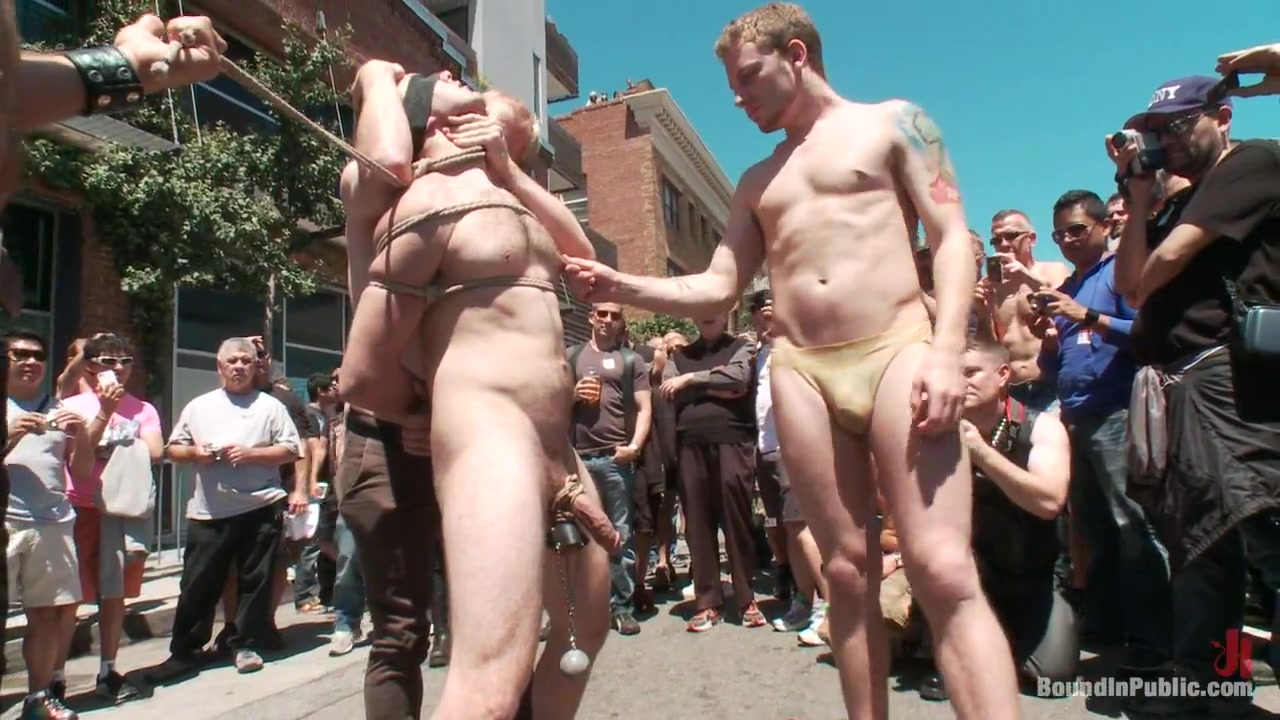 Naked girl tied up in public