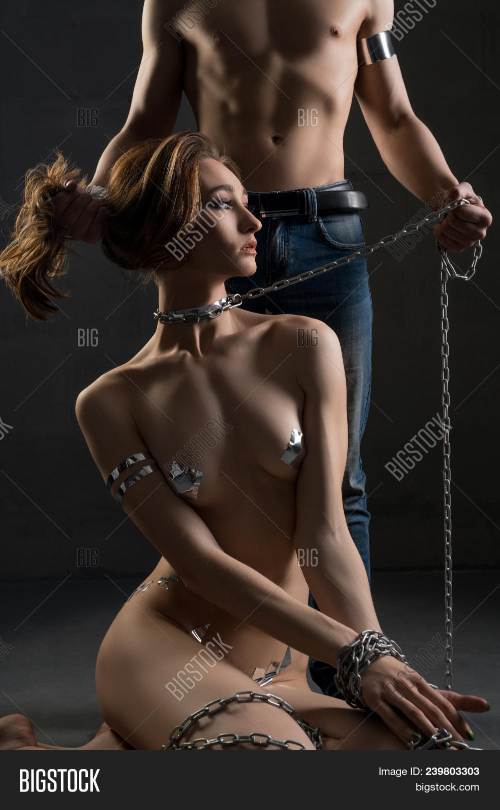 Naked woman on leash